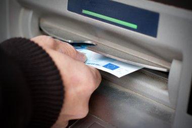 Getting cash at ATM machine