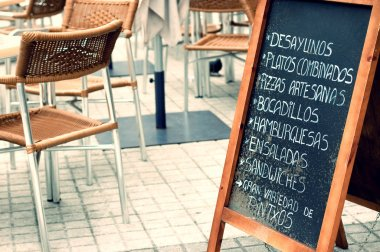 Tabloid with menu in a terrace