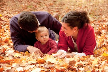 Happy family at the park in autumn