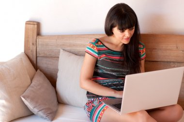 Young smiling woman using a laptop