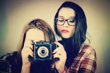 Hipster girls using an old camera