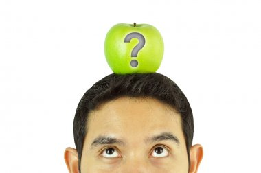 A man looking up to green apple