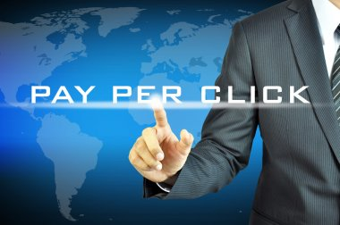 Businessman touching PAY PER CLICK on virtual screen