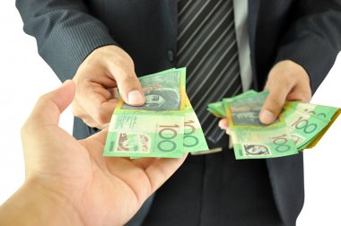 Hand receiving money - Australian dollar -  from a businessman