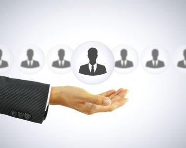 Hand holding businessman icon - HR concept
