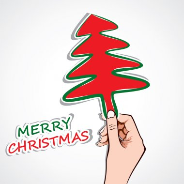 Christmas tree in hand stock vector