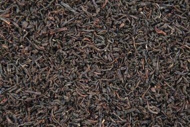 Black tea leaves background