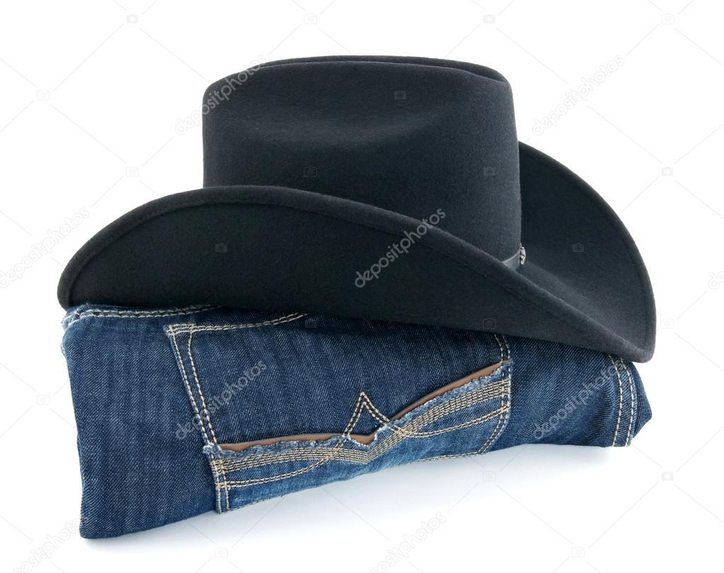 49814b1da kowbojski kapelusz i niebieskie dżinsy — Zdjęcie stockowe ...