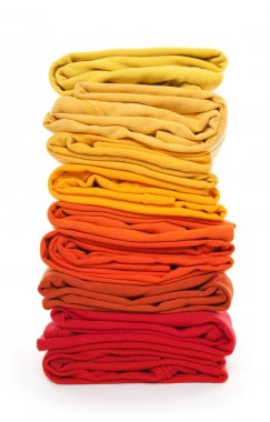 Pile of red and yellow folded clothes