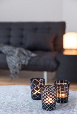 Tea-lights decorating living room with gray sofa
