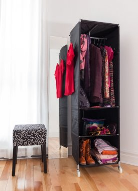 Mobile wardrobe with clothing and shoes