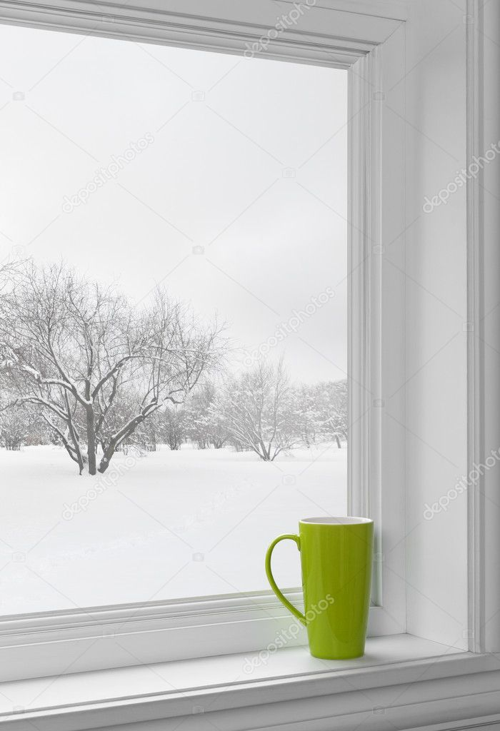 Green cup on a windowsill