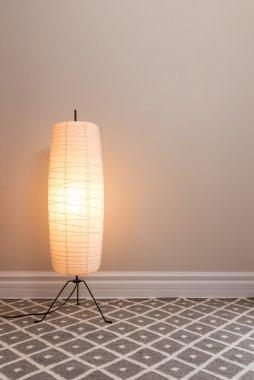 Cozy lamp in empty room
