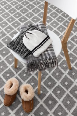 Warm winter clothes on a chair