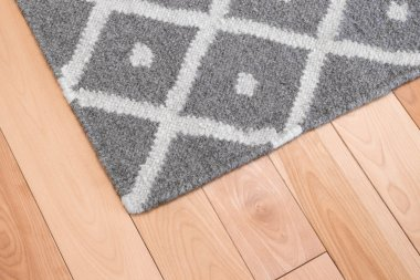 Gray rug on wooden floor