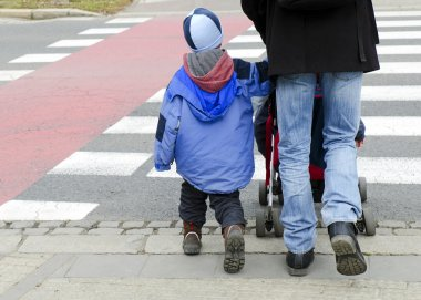 Father with children on zebra crossing