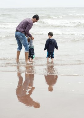 Father with children at beach