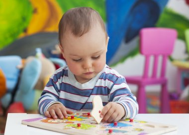 Toddler child playing with puzzle