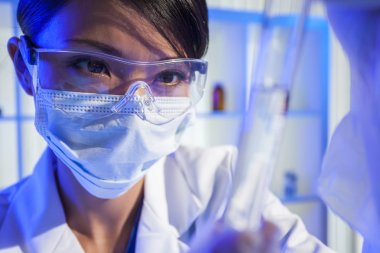 Chinese Female Woman Scientist With Test Tube In Laboratory