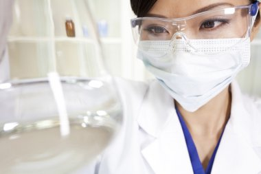 Chinese Female Woman Scientist With Flask In Laboratory