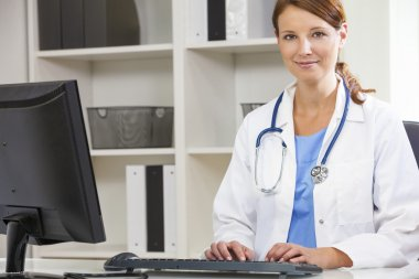 Female Woman Hospital Doctor Using Computer