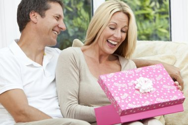 Happy Man & Woman Couple Opening Birthday Present