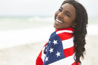 African American Woman Girl in American Flag on Beach