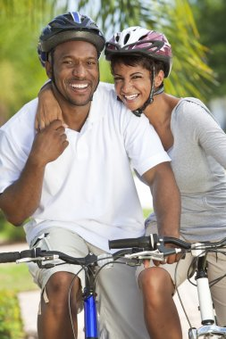 Happy African Man & Woman Couple Riding Bike Smiling
