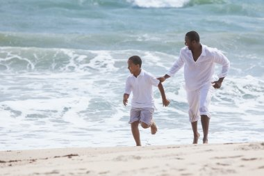 African American Father Son Family Running on Beach