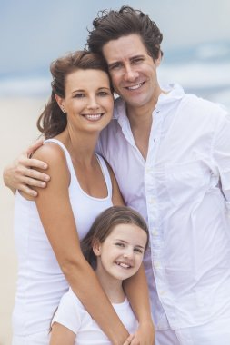 Mother, Father and Child Family Happy on Beach