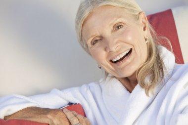 Happy Senior Woman Smiling in Spa Bathrobe