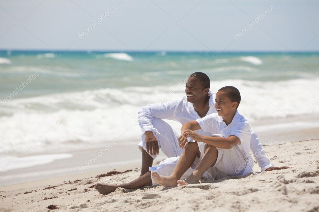 Happy African American Father and Son On Beach