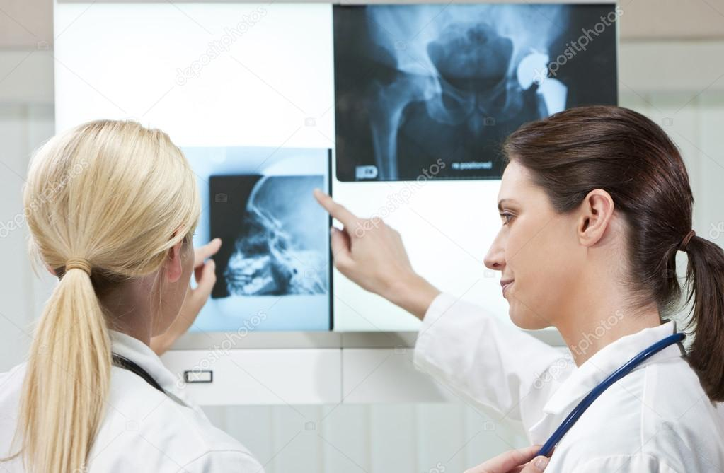 Two Female Woman Hospital Doctors with X-Rays
