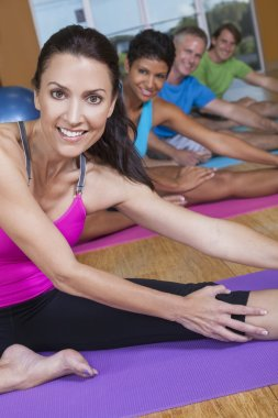 Interracial Group of Middle Aged Practicing Yoga