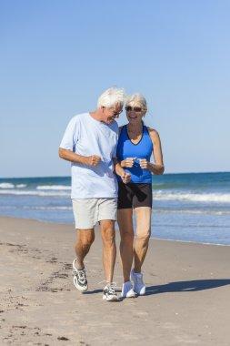 Healthy Senior Couple Running Jogging on Beach