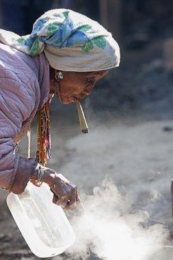 Unidentified  Hmong old woman smoking.