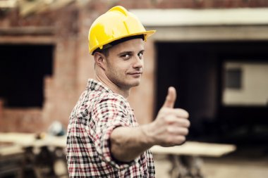 Construction worker gesturing thumbs up