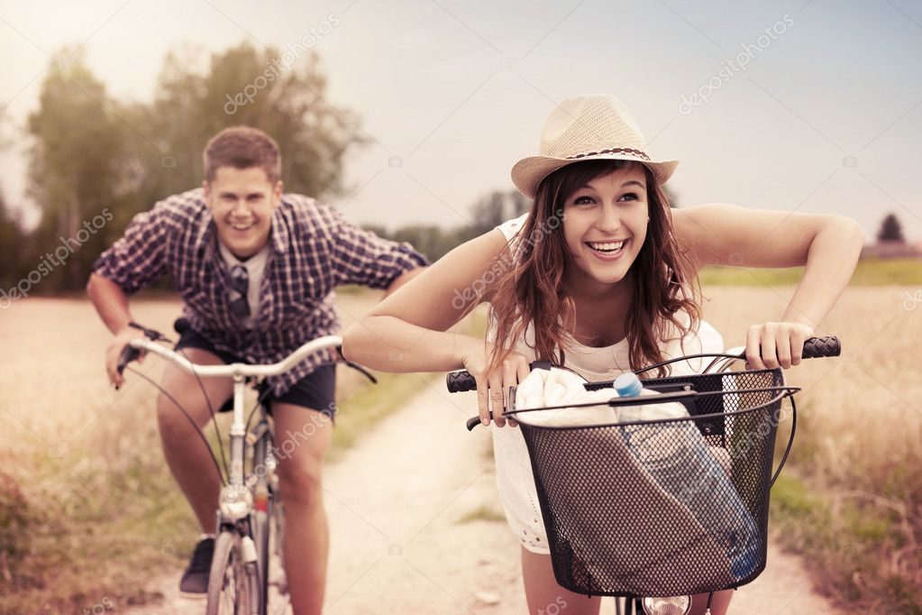 Couple racing on bikes