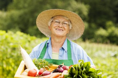Woman holding wooden box with vegetable