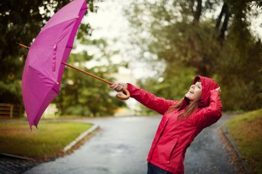 Young woman with pink umbrella