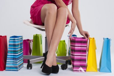 Sitting woman checks her shopping stock vector