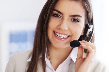 Happy female wearing headset