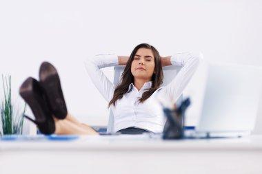 Businesswoman relaxing in office