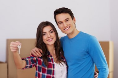 Young couple holding key in hand