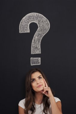 Big question mark on blackboard