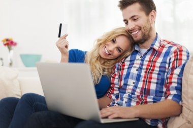 Young couple paying online by credit card
