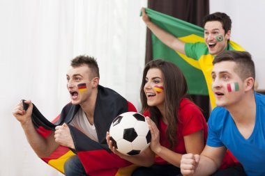 Young soccer fans during the match