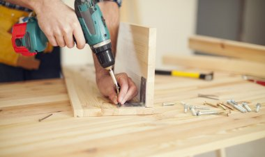 Carpenter working with drill