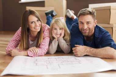 Family planning their new apartment