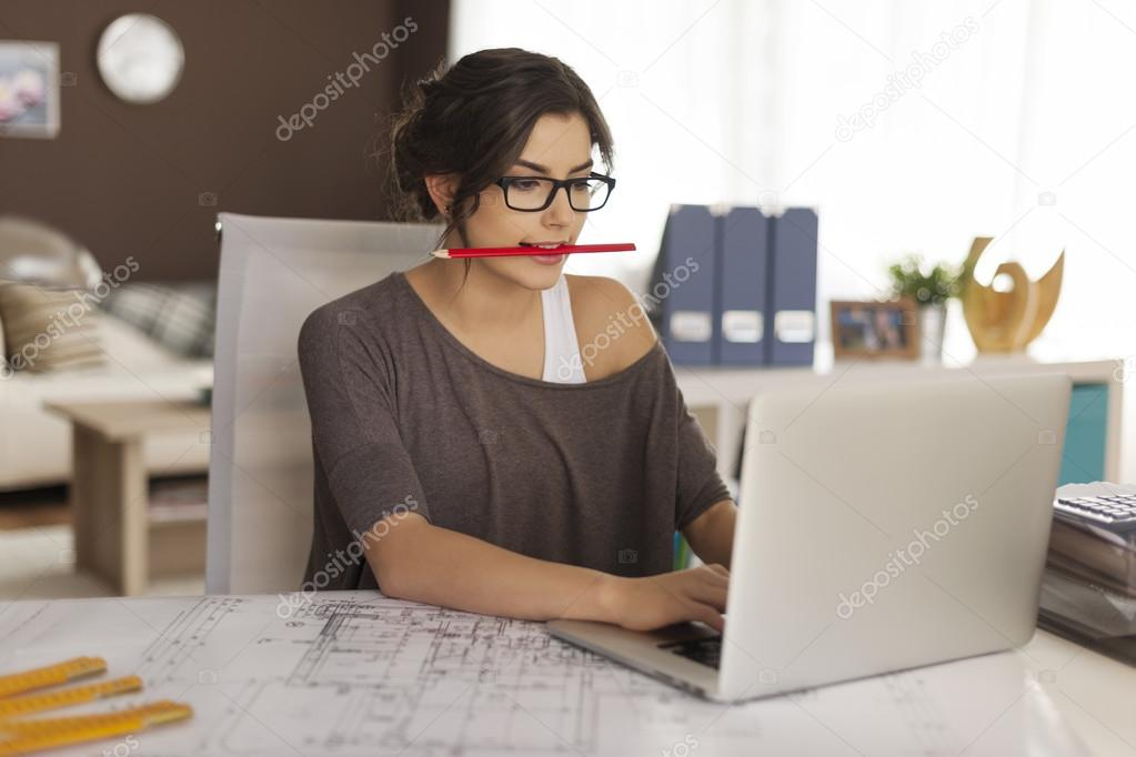 Young architect working at home